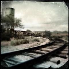 Around the Bend (~ Lone Wadi Archives ~) Tags: goldfieldarizona narrowgaugerailroad traintracks railroadtracks rails mammothmine oldwest americansouthwest pinalcounty watertower cloudy overcast