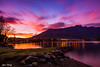 Remarkable Explosion (Stefan Nikoloff) Tags: sunrise queenstown frankton otago zealand new 2470mm d750 nikon lee filters exposure long jetty lake remarkables alps mountains rocks stones beach trees tree clouds boat houses blue red yellow epic amazing colour colourful