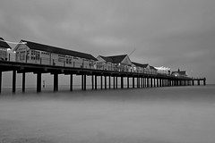 Southwold Pier Exposure (B/W) (DaveJC90) Tags: camera wood old longexposure light shadow sea sky blackandwhite bw cloud white house black colour detail reflection building slr classic beach water beautiful night digital dark walking lens bay coast pier town wooden suffolk twilight nikon long exposure gallery colours afternoon village angle bright cloudy path walk steel wide picture wideangle sharp hut northsea crop beachhut coastline 1855mm moment 1020mm footpath southwold dull pathway croped sharpness d5100