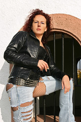 Doreen 16 (The Booted Cat) Tags: red sexy girl leather hair model ripped smoking jeans demin