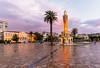 Izmir (Nejdet Duzen) Tags: trip travel sunset rain turkey square türkiye palm palmiye konak izmir günbatımı meydan towerclock turkei seyahat yağmur saatkulesi hükümetkonağı