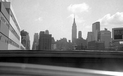 Grainy, gritty view of Midtown Manhattan, the Empire State Building and a billboard for Majorska Vodka taken from the West Side Highway. August 1972. (wavz13) Tags: city newyorkcity urban blackandwhite newyork manhattan grain citylife newyorkskyline manhattanskyline oldphotographs grainy oldphotos oldnewyork newyorkerhotel urbanphotography urbanphotos newyorkhistory 126film oldwestside verichrome newyorkbuildings vintagenewyork 1970sphotos manhattanbuildings oldmanhattan 1970sphotographs vintagemanhattan 1970snewyork 1970smanhattan 1970swestside manhattanhistory newyorkskyscapers 1970smidtown vintagemidtown oldmidtown vintagewestside