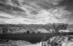 Beneath the Changing Sky (magnetic_red) Tags: sky blackandwhite mountains clouds river desert nevada rodinal expiredfilm pentax67ii agfapan apx25