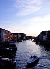 Venitian Sunset (-Reji) Tags: venice sunset reflection buildings boat nikon waves dusk venizia grandcanal gondolas d90 gondolaride sunsetcolours artitechture sunsettones rejik