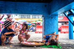 Hiding under the Police Station (petervandever) Tags: streetphotography manila hdrphotography sonynex manilamarkets