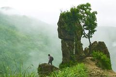 Depth (HegdeG) Tags: cliff man green rain rock season landscape hills coorg bold madikeri courage kumaraparvatha pushpagiri kukke