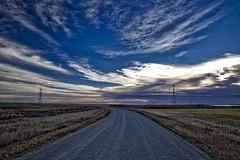 Prairie Sunrise at Frank Lake (John Andersen (JPAndersen images)) Tags: alberta clouds franklake road rockies sky telephoto zoom