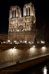 Alone together (Howard Ferrier) Tags: france sitting cathedral waterway religiousbuildings time darkness longexposure seine path lights paris river people couple night architecture facade notredamecathedralparis europe iledefrance iledelacite sit ledefrance fr