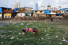 Moment - Mumbai, India (Maciej Dakowicz) Tags: india mumbaimcolaba cuffeparade slum city metropolis environment pollution boy jump streetphotography moment
