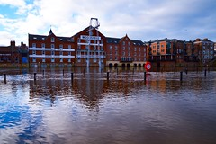 Garage to Let (rustyruth1959) Tags: nikon nikond3200 tamron16300mm outdoor city york yorkshire waterfront apartments buildings flood river water ouse riverouse lifering posts garage reflections flow architecture windows sky clouds woodsmillquay queensstaith kingsstaith flooding november arches blue