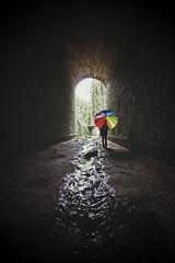 Tunnel End (CoolMcFlash) Tags: person umbrella tunnel water rainbow standing canon eos 60d woman regenschirm wasser regenbogen colors bunt colorful farben frau fotografie photography sigma 10mm fisheye fischauge dark dunkel