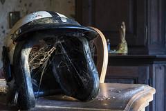 Ride on (Kriegaffe 9) Tags: helmet cobwebs sunlight dust 50mm