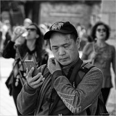 Itch (John Riper) Tags: johnriper street photography straatfotografie square vierkant bw black white zwartwit mono monochrome hungary budapest candid john riper fujifilm fuji xt1 18135 iphone man gentleman smart phone itch tourist cap