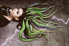 Spooky (sophiewighton) Tags: artisitic beauty cyberlocks fujifilmxt1 fujifilmxf35mmf2 gloves goth green lightening photojournalism portrait purple studio tough villain alternative dreadlocks
