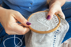 Woman hands doing openwork embroidery on homespun linen. (victoria.kondysenko) Tags: cloth colors cotton craft crossstitch dressmaker embroider embroidery female fingers handicrafts hands hobby homemade housework image linen material needle needlework pattern seam seamstress sew stitches string tailor textile thread white woman