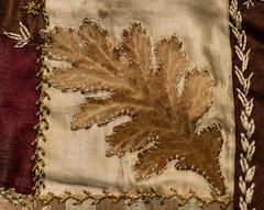 Crazy Quilt Design (NedraI) Tags: quilt antique crazyquilt stitch macro oakleaf design vintage fabric worn macromondays brown leaf variety