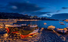 Giardini Naxos at Dawn (Bommer60) Tags: giardininaxos sicilia italy taormina 24120mm nikond7000 sicily italien longexposure landscape landschaft mediterranean mediterraneansea beach strand movement dawn earlymorning sunrise boats shore sand waterfront skyline outdoor boat water sea