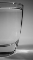 Not Quite Half Full (Catskills Photography) Tags: odc glassofwater abstract bokeh blackandwhite canon24mmf28stmlens