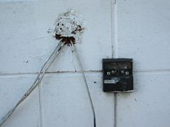 Just another hole in the wall (jamica1) Tags: wall cinder block wires control box