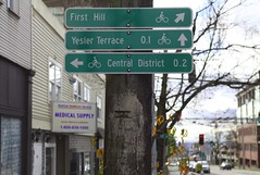 """Appreciating community art with slower pace of walking and riding a bicycle. """"Heart""""-felt love for the Central District (Seattle Department of Transportation) Tags: seattle sdot transportation donghochang wayfinding sign heart heartfelt art centraldistrict yesler"""