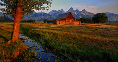 First Light on the Barn - Circa 2007 (Jeff Clow) Tags: grandtetonnationalpark mormonrow jacksonholewyoming moultonbarn thomasamoultonbarn