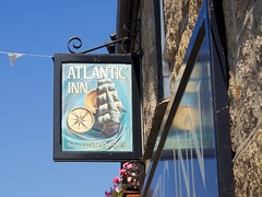Atlantic Inn (chrisotruro) Tags: ocean blue sea summer sky black reflection sunshine sign metal island gold pub marine ship turquoise wroughtiron september reflected faded maritime granite lettering nautical ios compass scilly stmarys islesofscilly