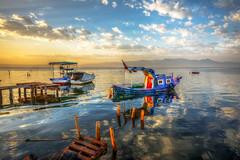 Boats of Bostanl (Nejdet Duzen) Tags: trip travel sea reflection turkey boat cloudy jetty trkiye deniz iskele sandal izmir turkei seyahat gndoumu bostanl bulutlu maviehir yansmasunrise