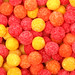Round sugar sweets of red and yellow color