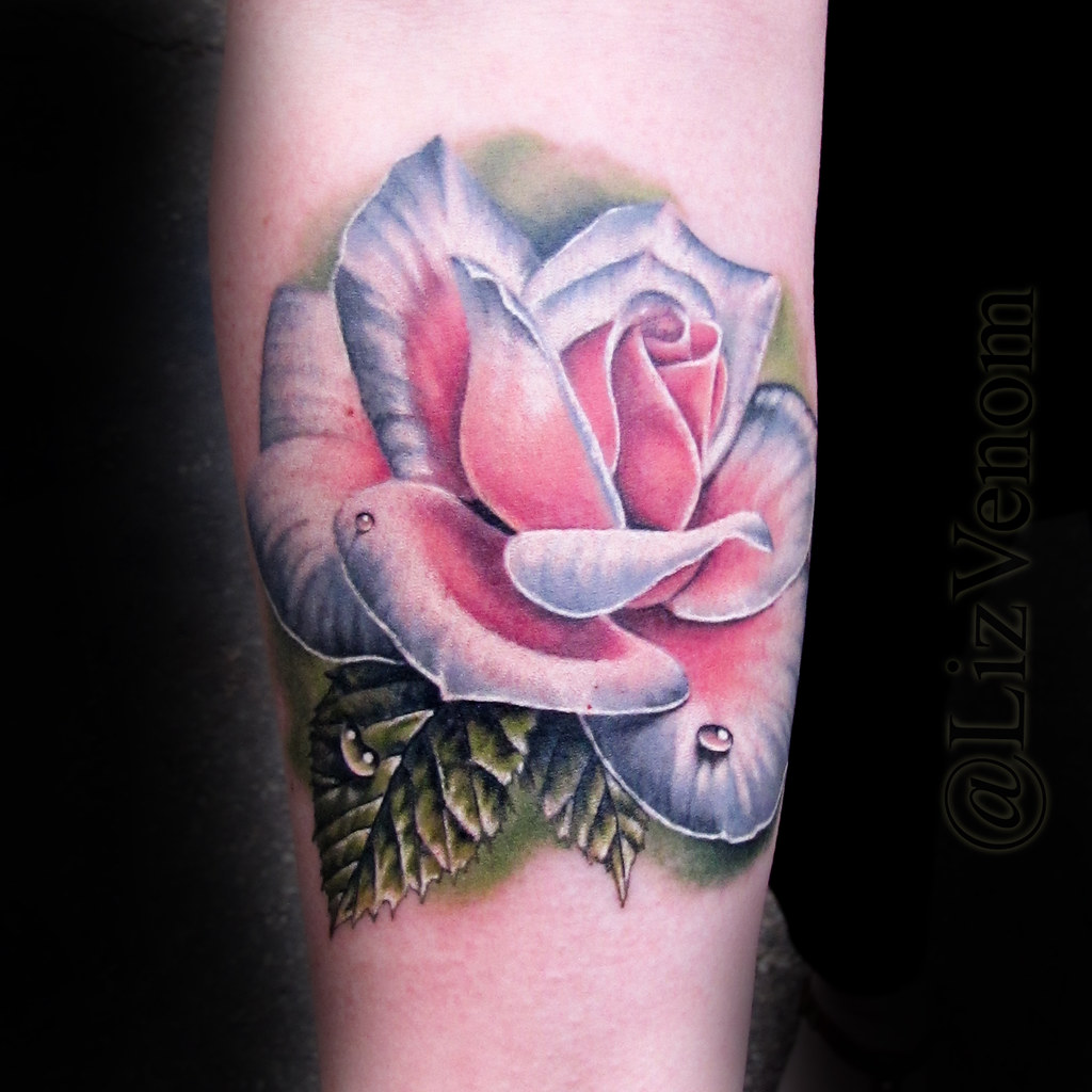 Light pink rose tattoo