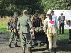 Soldiers wheel a casualty to the medics 11Oct14