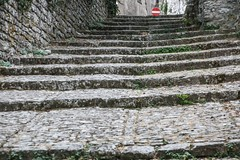 Erice - stepped street 1 (nican45) Tags: 09092016 18270 18270mm 18270mmf3563diiivcpzd 2016 9september2016 canon dslr eos70d erice italia italy middleages slr september sicilia sicily tamron trapani citywall medieval paved paving steps stone street