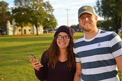 Out catching Pokemon (radargeek) Tags: waco tx texas downtown couple cellphone pokemongo tattoo glasses
