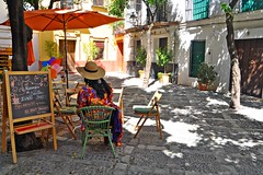 (yonca60) Tags: seville sevilla spain andalusia street woman spanishwoman hat cafe houses casa calle colorfulstreets