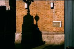 Smoke break (Joe Alcorn) Tags: film 35mm london shadow contrast station smoke break street
