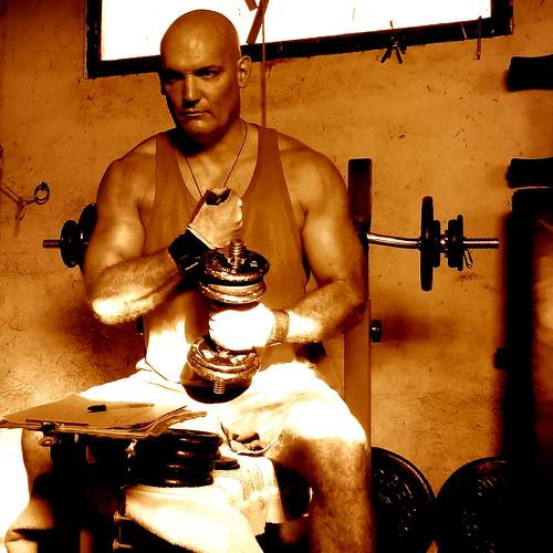 man weight training home gym