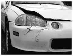 del Sol deface (daveelmore) Tags: bw broken car honda blackwhite automobile bumper headlight delsol bent damaged wrecked cracked defaced
