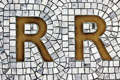 The letter 'R' on the ground (DigiPub) Tags: japan vertical metal stone tile photography mosaic r copper letter yokohama onsale rejected gettyimages humaninterest colorimage mr20141120 o20141127 525600555
