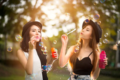 Beautiful asian teen girls blowing soap bubbles (Patrick Foto ;)) Tags: park girls friends summer two portrait people urban woman sunlight green nature girl beautiful beauty smile grass female youth laughing asian fun thailand outdoors happy freedom spring soap pretty friendship adult outdoor background joy young meadow lifestyle happiness bubbles blowing blow teen relationship thai attractive bubble concept copyspace cheerful joyful