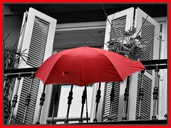 It's raining a lot, in Italy! (collage42 Pia M.-Vittoria S.) Tags: windows umbrella bilbao spagna paesibaschi selectivecolours desaturadoselectivo ombrellorosso nikond90 desaturazioneparziale