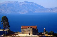 Telephoto (500mm) (GEORGE TSIMTSIMIS) Tags: travel blue sea mountain film landscape pentax chapel greece velvia slides fujichrome parnassos 50asa pentaxlx korinthos 35mmphoto analoguephoto