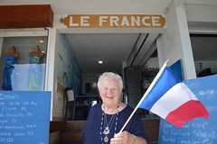 Theresa Irene Wolowski, waving the national flag of France while visting Le France restaurant and café in Marigot, Saint-Martin, Caribbean Island in the French West Indies (RYANISLAND) Tags: france west saint french island islands saintmartin martin tropical tropic caribbean indies caribbeansea marigot frenchwestindies fwi caribbeanislands frenchisland frenchrepublic caribbeanisland friendlyisland thefriendlyisland