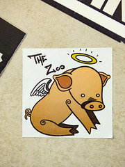 The Zoo (Steve Taylor (Photography)) Tags: pig zoo angel halo wings flyingpig art cartoon graffiti sticker streetart black brown white yellow sad paper newzealand nz southisland canterbury christchurch cbd city whenpigsfly