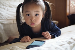 got caught playing game before bed time (tom120879) Tags: child children bed room phone game playing