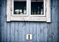 Primo Fenestro (claustral) Tags: window old number 1 bottles aged muted blue white malm decaying sweden tr wood skylt nummer ett fnster scottkelbyinternationalphotowalk2016 2016
