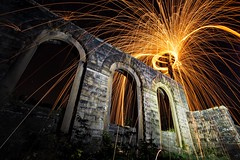 Errwood Hall on Fire (Ben Lockett) Tags: peakdistrict district peak torch 1740l 5d canon cliche nightscape dark shower sparks night circle high old arches arch folly ruin errwood steel light trails moletn fire wool wire