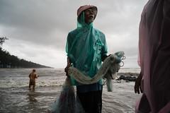 * (Sakulchai Sikitikul) Tags: street snap streetphotography summicron songkhla sony 28mm voigtlander thailand seascape sea samilabeach raincoat fisherman