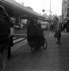 (cross lines) (Dinasty_Oomae) Tags: zeissikon    supersix superikonta  blackandwhite bw monochrome outdoor jmsdf    tokyo chiyodaku kandasakumacho  akihabara  wheelchair