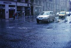 . (LauraKiora) Tags: sprocketrocket 35mmfilm filmphotography 35mmfilmphotography lomography paris france 35mm ishootfilm filmisnotdead doubleexposure car street traffic rain weather wet