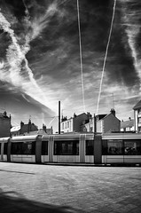 Apocalyptic atmosphere (Vanvan_fr) Tags: noiretblanc bw nb blackandwhite tram tramway ville city vide empty ombre shadow ciel sky torturedsky clouds nuages urbain urban street rue streetphotography lines tours france apocalypticatmosphere photo gr traineblanchedavion whitetrailofaplane