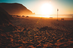 Endless Possibilities (thethomsn) Tags: endless beach sunset backlight bright amazing holiday vacation travel portugal europe cliff coast beautyinnature rocks colorful faded footprint warmness flare summer moment mood sunshade